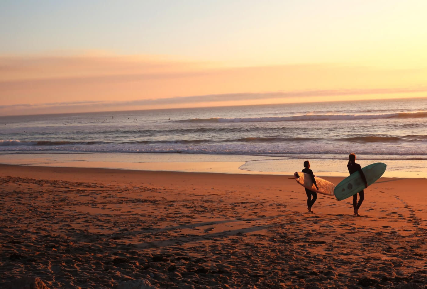 two surfers on beach